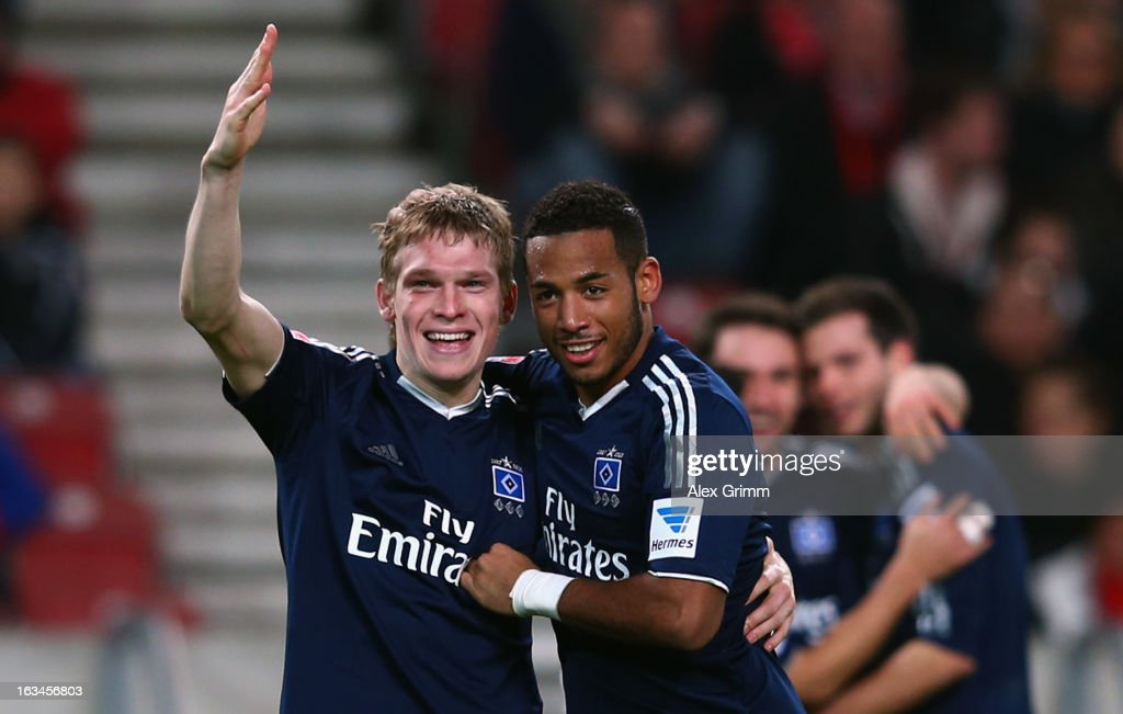 Artjoms Rudnevs (L) of Hamburg celebrates his team's third goal with team mate <a gi-track='captionPersonalityLinkClicked' href=/galleries/search?phrase=Dennis+Aogo&family=editorial&specificpeople=787086 ng-click='$event.stopPropagation()'>Dennis Aogo</a> during the Bundesliga match between VfB Stuttgart and Hamburger SV at Mercedes-Benz Arena on March 10, 2013 in Stuttgart, Germany.