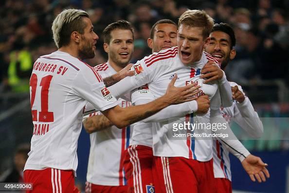 Artjoms Rudnevs of Hamburg celebrates scoring the opening goal with his team mates during the Bundesliga match between Hamburger SV and SV Werder...