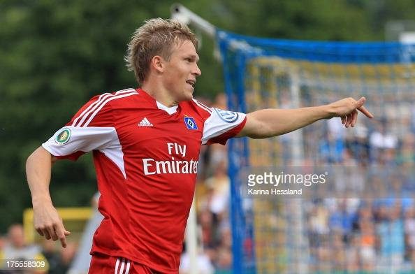 Artjoms Rudnevs of Hamburg celebrates the opening goal during the DFB Cup between SV Schott Jena and Hamburger SV at ErnstAbbeSportfeld on August 04...