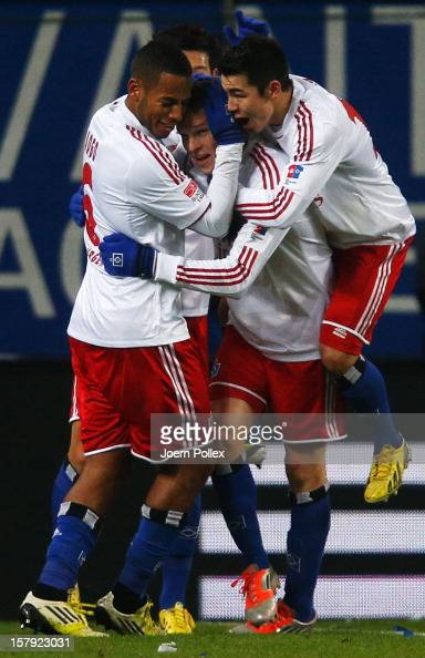 Artjoms Rudnevs of Hamburg celebrates with his team mates after scoring his team's first goal during the Bundesliga match between Hamburger SV and...