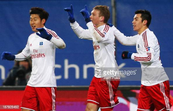 Artjoms Rudnevs of Hamburg celebrates with his team mates after scoring his team's second goal during the Bundesliga match between Hamburger SV and...