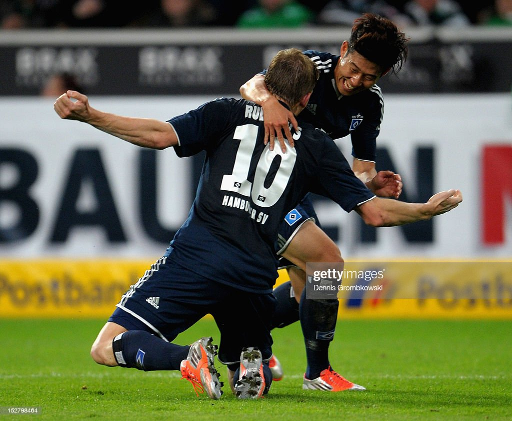 Artjoms Rudnevs of Hamburg celebrates with teammate Heung Min Son after scoring his team's second goal during the Bundesliga match between Borussia Moenchengladbach and Hamburger SV at Borussia Park Stadium on September 26, 2012 in Moenchengladbach, Germany.