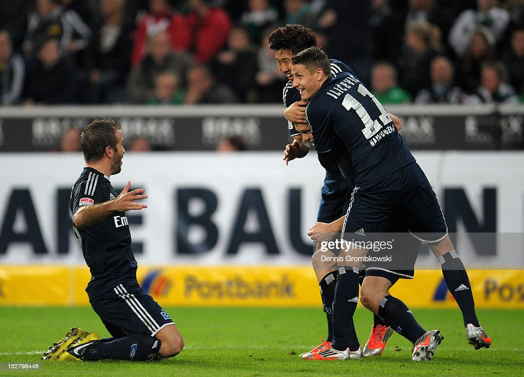 Artjoms Rudnevs of Hamburg celebrates with teammates after scoring his team's second goal during the Bundesliga match between Borussia Moenchengladbach and Hamburger SV at Borussia Park Stadium on September 26, 2012 in Moenchengladbach, Germany.