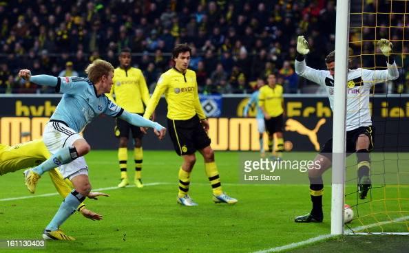 Artjoms Rudnevs of Hamburg heads his teams third goal during the Bundesliga match between Borussia Dortmund and Hamburger SV at Signal Iduna Park on...
