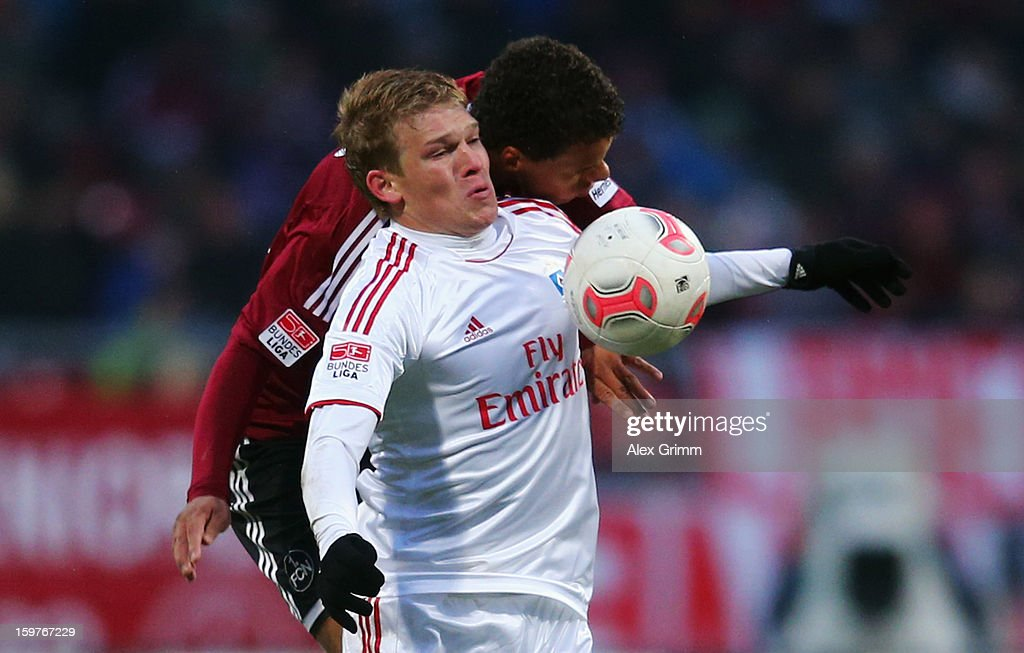 Artjoms Rudnevs (front) of Hamburg is challenged by Timothy Chandler of Nuernberg during the Bundesliga match between 1. FC Nuernberg and Hamburger SV at Easy Credit Stadium on January 20, 2013 in Nuremberg, Germany.