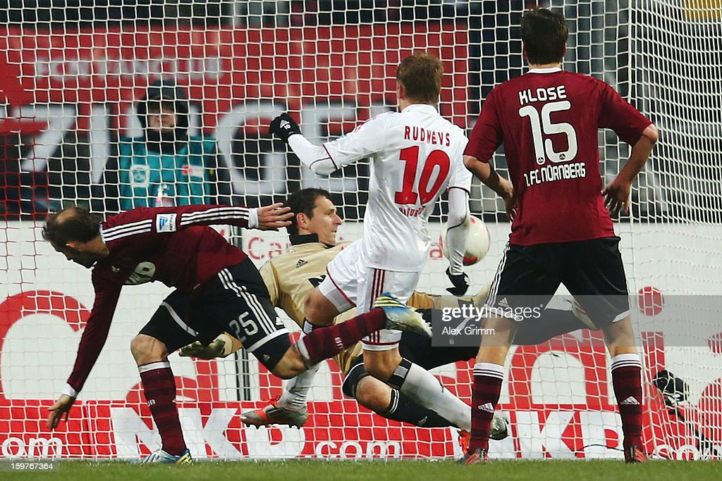 Artjoms Rudnevs (C) of Hamburg scores his team's first goal during the Bundesliga match between 1. FC Nuernberg and Hamburger SV at Easy Credit Stadium on January 20, 2013 in Nuremberg, Germany.