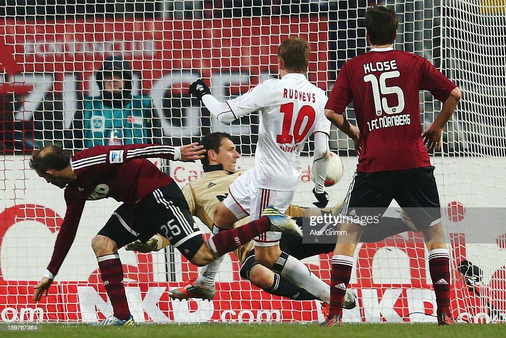 Artjoms Rudnevs (C) of Hamburg scores his team's first goal during the Bundesliga match between 1. FC Nuernberg and Hamburger SV at Easy Credit Stadium on January 20, 2013 in Nuremberg, Germany.