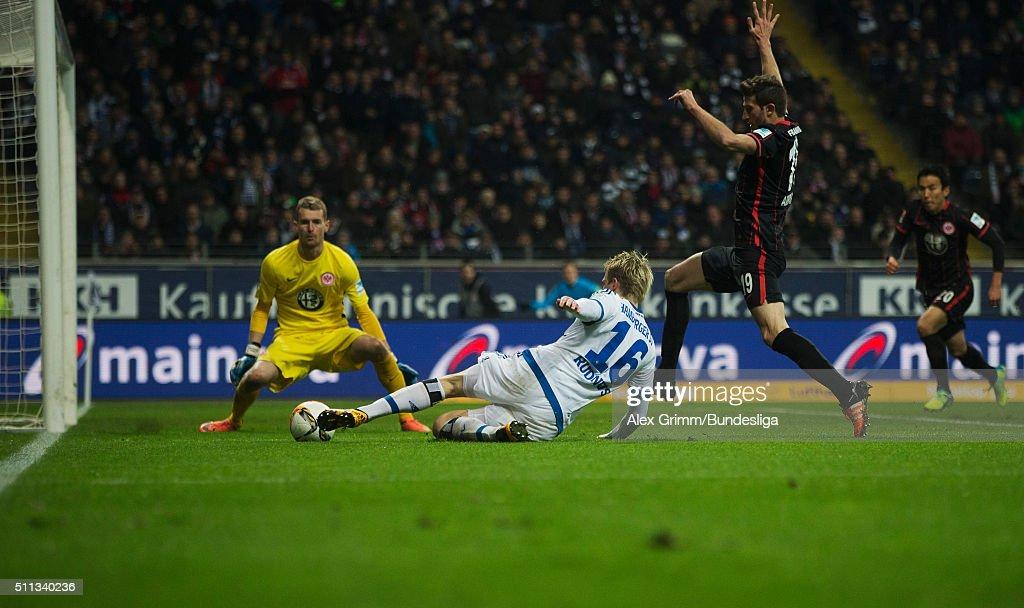 Artjoms Rudnevs of Hamburg tries to score against David Abraham and goalkeeper Lukas Hradecky of Frankfurt during the Bundesliga match between...