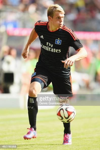 Artjoms Rudnevs of Hamburger SV controls the ball during the Telekom Cup 2014 third place match between Borussia Moenchengladbach and Hamburger SV at...