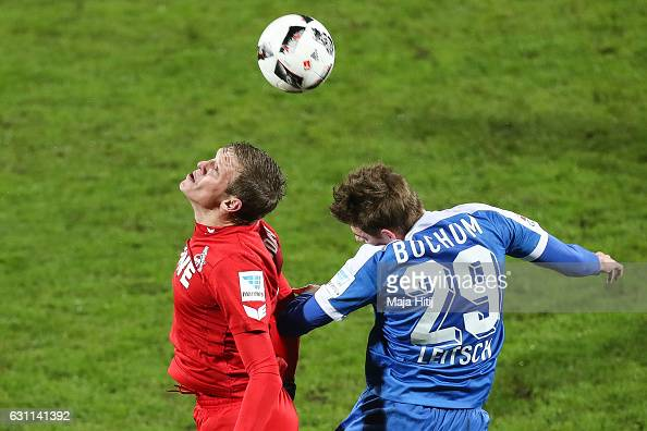 Artjoms Rudnevs of Koeln is challenged by Maxim Leitsch of Bochum during a friendly match between VfL Bochum and 1 FC Koeln at Vonovia Ruhrstadion on...