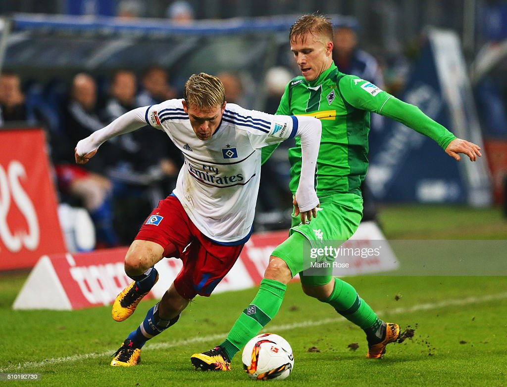 Artjoms Rudnevs of SV Hamburg evades <a gi-track='captionPersonalityLinkClicked' href=/galleries/search?phrase=Oscar+Wendt&family=editorial&specificpeople=3016222 ng-click='$event.stopPropagation()'>Oscar Wendt</a> of Borussia Moenchengladbach during the Bundesliga match between Hamburger SV and Borussia Moenchengladbach at Volksparkstadion on February 14, 2016 in Hamburg, Germany.