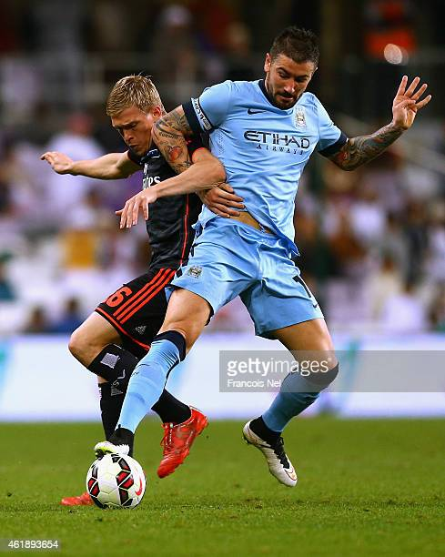 Artjons Rudnevs of Hamburg competes for the ball with Aleksander Kolarov of Manchester City during the friendly match between Hamburg SV and...