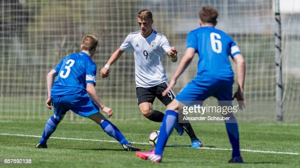 Arttu Eerola of Finland challenges JannFiete Arp of Germany during the UEFA U17 elite round match between Germany and Finland on March 25 2017 in...