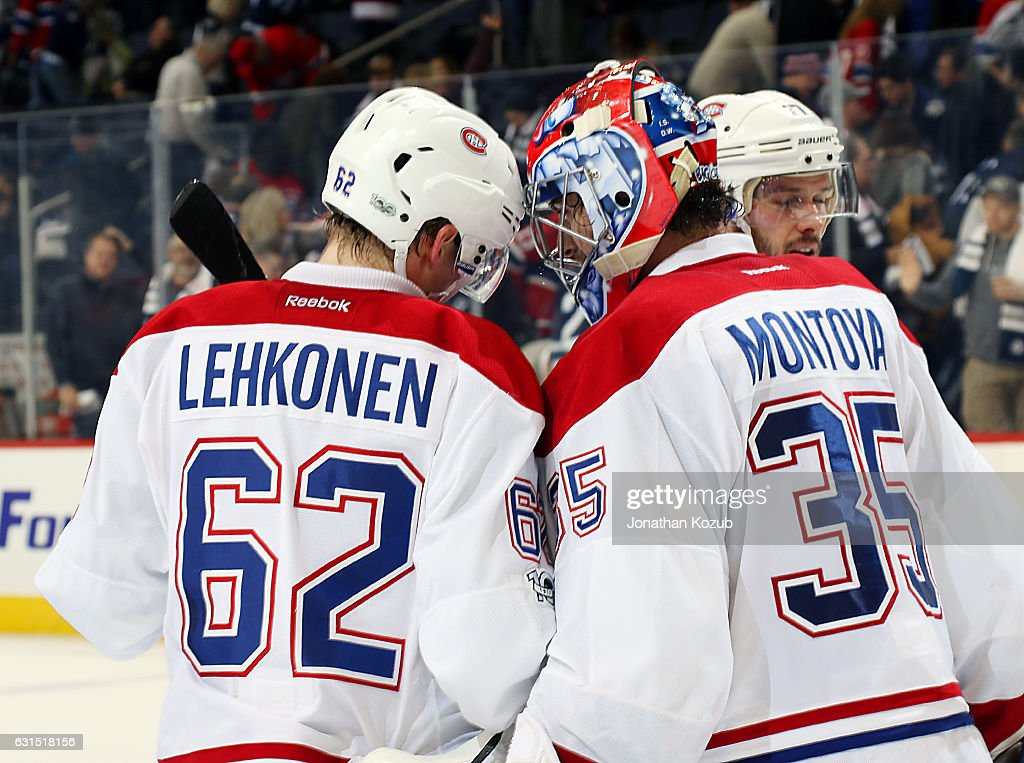 Artturi Lehkonen #62 and goaltender Al Montoya #35 of the Montreal Canadiens celebrate a 7-4 victory over the Winnipeg Jets at the MTS Centre on January 11, 2017 in Winnipeg, Manitoba, Canada.