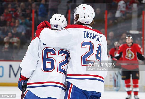 Artturi Lehkonen of the Montreal Canadiens celebrates his first career NHL goal during a game against the Ottawa Senators with teammate Phillip...