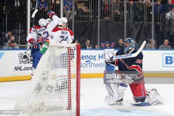 Artturi Lehkonen of the Montreal Canadiens celebrates his goal in the second period with teammates against Henrik Lundqvist of the New York Rangers...