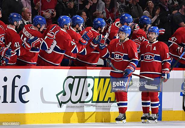 Artturi Lehkonen of the Montreal Canadiens celebrates with the bench after scoring a goal against the Minnesota Wild in the NHL game at the Bell...