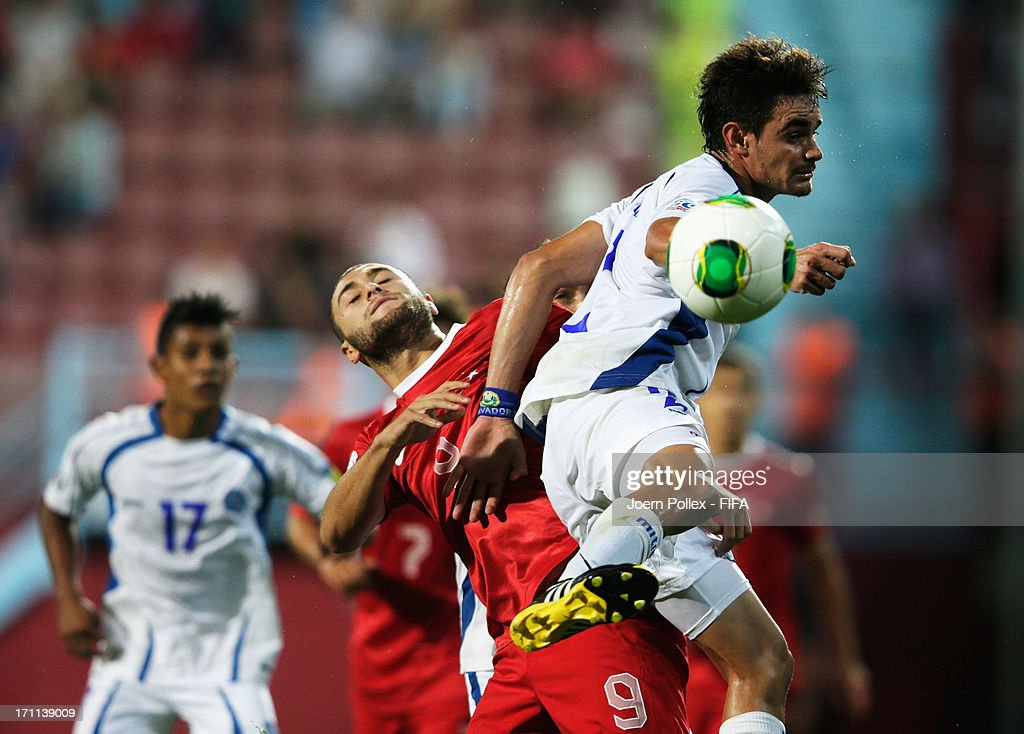 Artun Akcakin (L) of Turkey and Olivier Ayala of El Salvador compete for the ball during the FIFA U-20 World Cup Group C match between Turkey and El Salvador at Huseyin Avni Aker Stadium on June 22, 2013 in Trabzon, Turkey.
