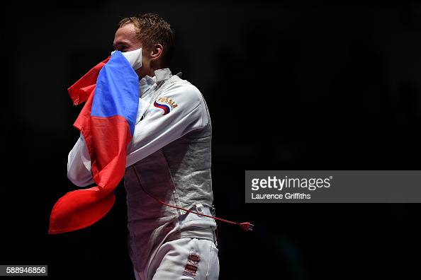 Artur Akhmatkhuzin of Russia celebrates winning gold in the Men's Team Foil event on Day 7 of the Rio 2016 Olympic Games at Carioca Arena 3 on August...