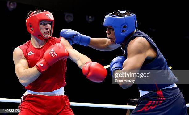 Artur Beterbiev of Russia in action with Michael Hunter II of United States during the Men's Heavy Boxing on Day 5 of the London 2012 Olympic Games...