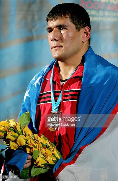 Artur Beterbiev of Russia stands on the victory podium after his win over Abbos Atoev of Uzebekistan in the 81 kg division during the finals of the...