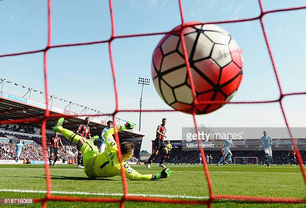 Artur Boruc of Bournemouth dives in vain as Kevin de Bruyne of Manchester City scores his team's second goal during the Barclays Premier League match...