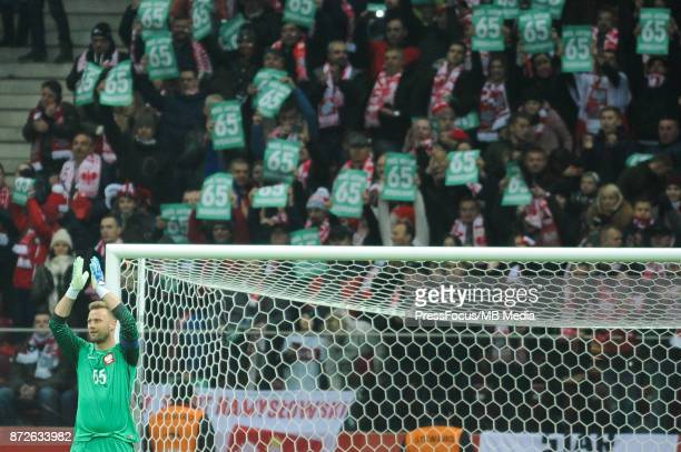 Artur Boruc of Poland applauds as he makes his final international appearance in his 65th game for the Polish national team during the international...