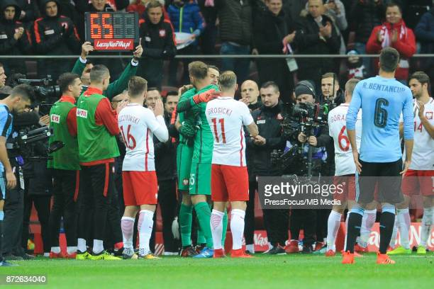 Artur Boruc of Poland is appluaded by teammates as he makes his final international appearance in his 65th game for the Polish national team during...