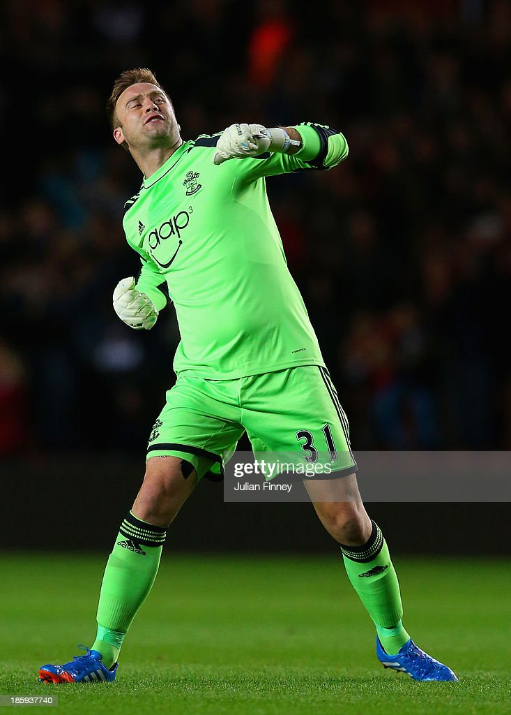 <a gi-track='captionPersonalityLinkClicked' href=/galleries/search?phrase=Artur+Boruc&family=editorial&specificpeople=554761 ng-click='$event.stopPropagation()'>Artur Boruc</a> of Southampton celebrates after Jay Rodriguez of Southampton (not pictured) scores their second goal during the Barclays Premier League match between Southampton and Fulham at St Mary's Stadium on October 26, 2013 in Southampton, England.