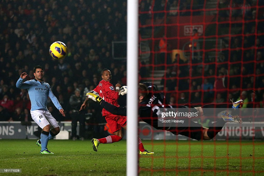 <a gi-track='captionPersonalityLinkClicked' href=/galleries/search?phrase=Artur+Boruc&family=editorial&specificpeople=554761 ng-click='$event.stopPropagation()'>Artur Boruc</a> of Southampton makes a save from <a gi-track='captionPersonalityLinkClicked' href=/galleries/search?phrase=Sergio+Aguero&family=editorial&specificpeople=1100704 ng-click='$event.stopPropagation()'>Sergio Aguero</a> of Manchester City during the Barclays Premier League match between Southampton and Manchester City at St Mary's Stadium on February 9, 2013 in Southampton, England.