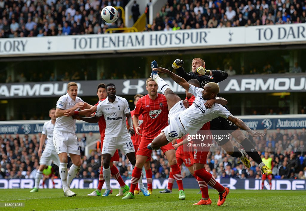 Artur Boruc of Southampton punches the ball clear of Jermain Defoe of Tottenham Hotspur during the Barclays Premier League match between Tottenham Hotspur and Southampton at White Hart Lane on May 4, 2013 in London, England.