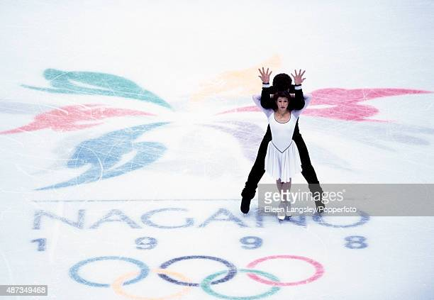 Artur Dmitriev and Oksana Kazakova of Russia competing in the pairs figures skating event during the Winter Olympic Games in Nagano Japan circa...
