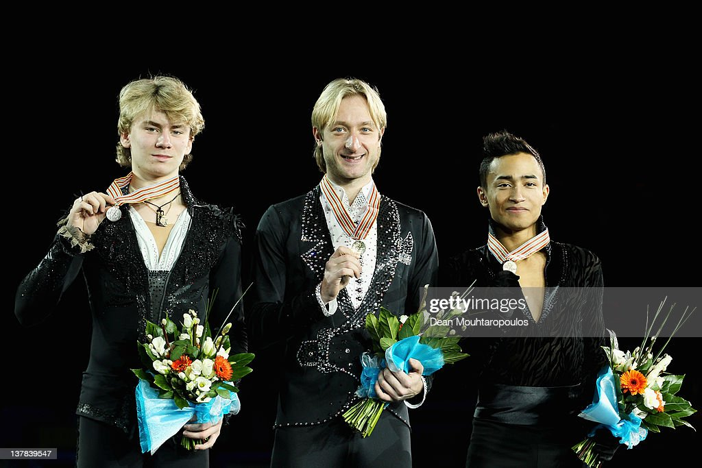 Artur Gachinski (silver) of Russia, Evgeni Plushenko (gold) of Russia and Florent Amodio (bronze) of France pose with their medals after the Mens Ice Dance Free Dance during the ISU European Figure Skating Championships at Motorpoint Arena on January 28, 2012 in Sheffield, England.