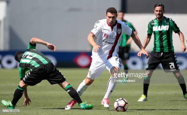 Artur Ionita of Cagliari Calcio competes for the ball with Stefano Sensi of US Sassuolo Calcio during the Serie A match between US Sassuolo and...