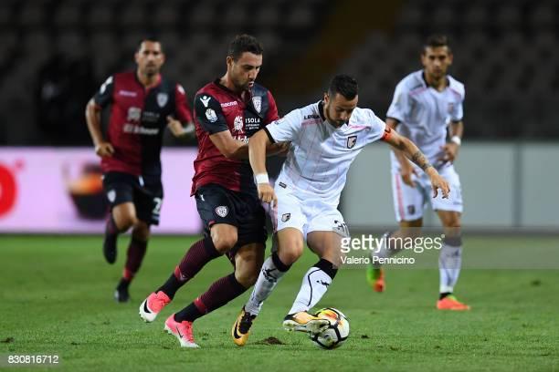 Artur Ionita of Cagliari Calcio competes with Ilja Nestorovski of US Citta di Palermo during the TIM Cup match between Cagliari Calcio and US Citta...