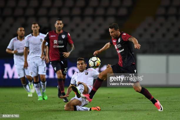 Artur Ionita of Cagliari Calcio is challenged by Ivaylo Chochev of US Citta di Palermo during the TIM Cup match between Cagliari Calcio and US Citta...