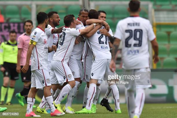 Artur Ionita of Cagliari celebrates with team mates after scoring the equalizing goal during the Serie A match between US Citta di Palermo and...