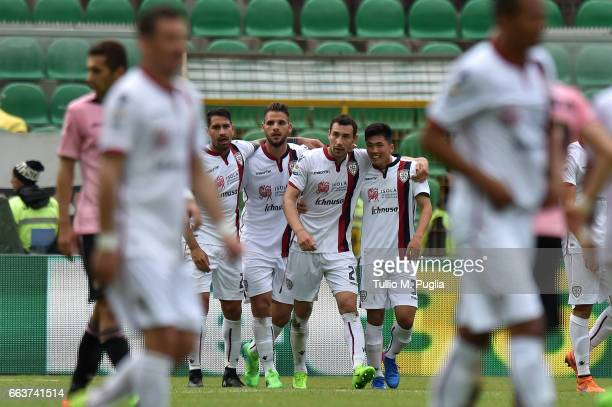 Artur Ionita of Cagliari is celebrated after scoring his team's third goal during the Serie A match between US Citta di Palermo and Cagliari Calcio...