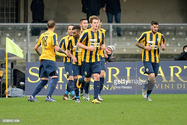 Artur Ionita of Hellas Verona is mobbed by team mates after scoring his team's third goal during the Serie A match between Hellas Verona FC and FC...