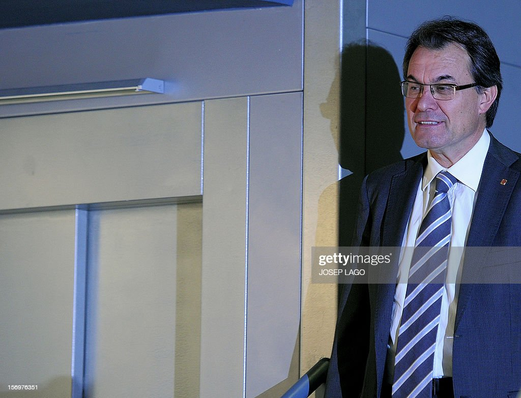 Artur Mas, Catalan president and leader of the Catalan Convergence and Unity party (CiU), arrives at a press conference in Barcelona on November 26, 2012. Catalonia's fight for statehood and a historic divorce from Spain floundered today after a snap election left no single party in command. Mas' centre-right nationalist alliance, Convergence and Union, remained well ahead in the vote but its share of the 135 parliamentary seats plunged from 62 to just 50. AFP PHOTO / JOSEP LAGO