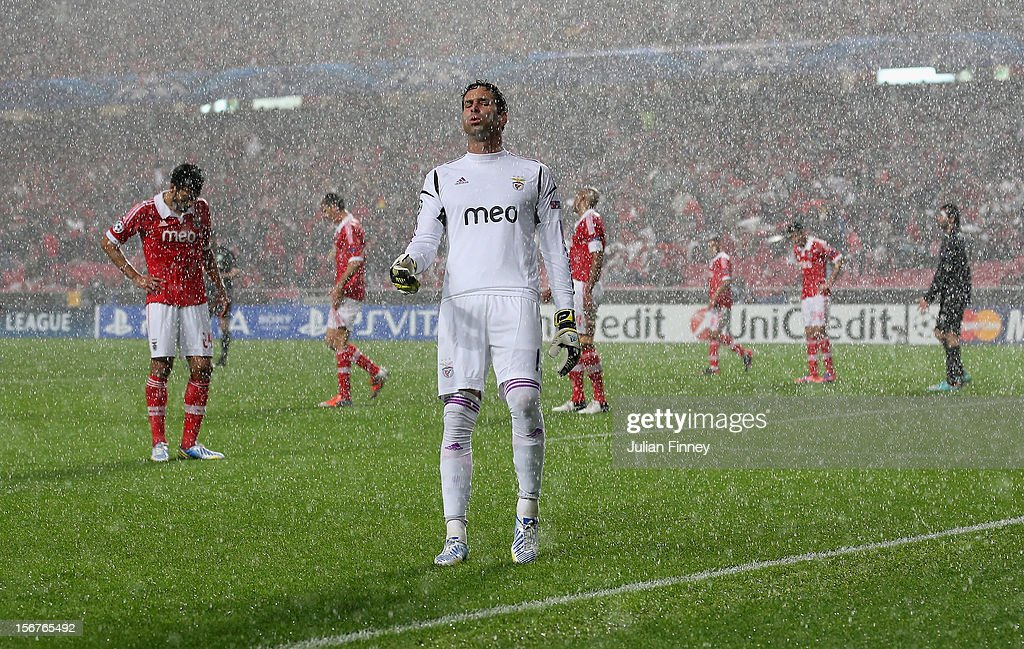Artur of Benfica looks on in the pouring rain during the UEFA Champions League, Group G match between SL Benfica and Celtic FC at Estadio da Luz on November 20, 2012 in Lisbon, Portugal.