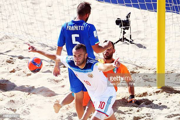 Artur Paporotnyi of Russia celebrates a goal during the FIFA Beach Soccer World Cup Portugal 2015 Third Place match between Italy and Russia at...