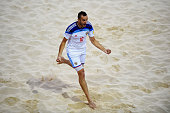 Artur Paporotnyi of Russia celebrates as he scores their first goal during the Men's Beach Soccer semi final match between Portugal and Russia during...