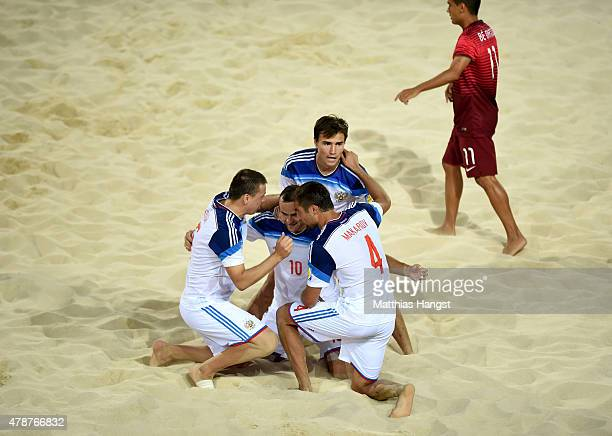 Artur Paporotnyi of Russia celebrates with team mates as he scores thei second goal during the Men's Beach Soccer semi final match between Portugal...