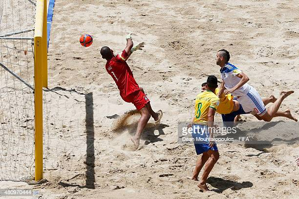 Artur Paporotnyi of Russia heads and scores a goal past goalkeeper Mao of Brazil during the FIFA Beach Soccer World Cup quarter final match between...