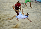 Artur Paporotnyi of Russia is challenged by Nuno Belchior of Portugal during the Men's Beach Soccer semi final match between Portugal and Russia...