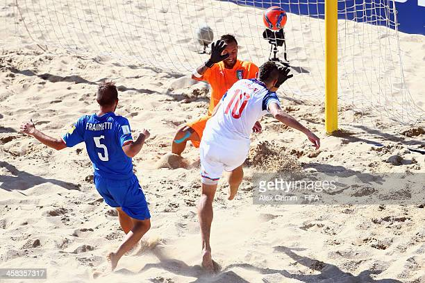 Artur Paporotnyi of Russia scores a goal against goalkeeper Stefano Spada and Alessio Frainetti of Italy during the FIFA Beach Soccer World Cup...