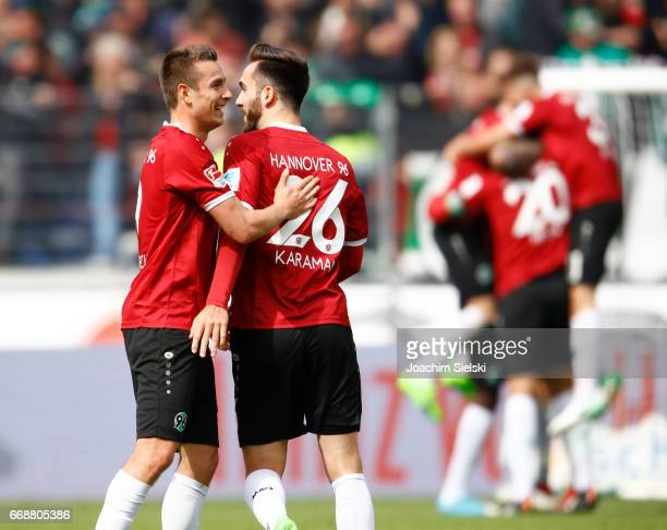 Artur Sobiech and Kenan Karaman of Hannover celebration after the Second Bundesliga match between Hannover 96 and Eintracht Braunschweig at HDIArena...