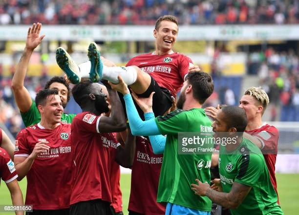 Artur Sobiech is held high as he leads the players of Hannover celebration of promotion after the Second Bundesliga match between Hannover 96 and VfB...