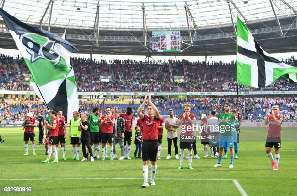 Artur Sobiech leads the players of Hannover celebration of promotion after the Second Bundesliga match between Hannover 96 and VfB Stuttgart at...